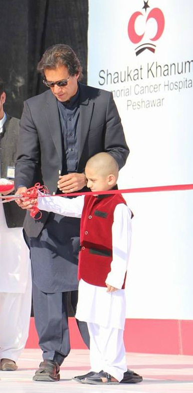 Imran Khan with Fakhir Afridi cutting the tape.